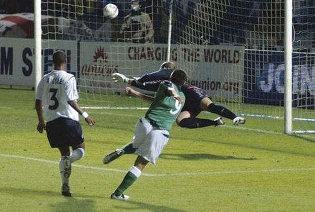 Northern Ireland No 9 David Healy scores the winning goal against England at Windsor Park,Belfast as they won 1-0 in the World Cup Qualifying match.