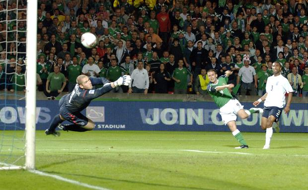 Northern Ireland 's David Healy scores the goal which beat England in the World Cup Qualifier against England at Belfast's Windsor Park.