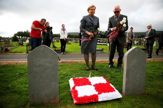 Polish MEP Anna Fotyga and ECR Group Deputy Secretary General Gabriel Beszlej (right) lay wreaths at the graves of seven Polish airmen, killed during the Second World War, at Milltown Cemetery, west Belfast. Photo: Brian Lawless/PA
