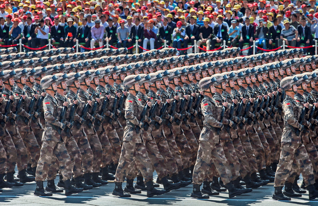 Chinese soldiers march in formation passed Tiananmen Square and the Forbidden City during a military parade on September 3, 2015 in Beijing, China. (Photo by Kevin Frayer/Getty Images)