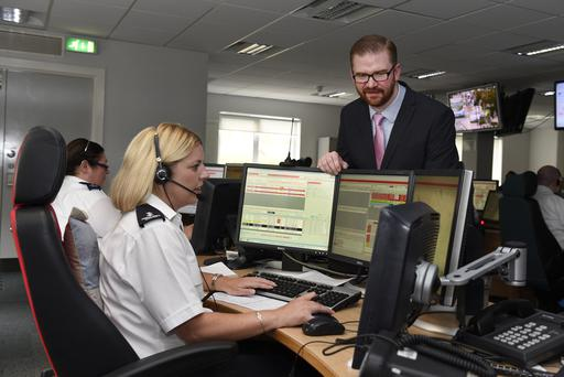Health Minister Simon Hamilton with Nicola McAuley, Rapid Response Control Officer during a visit to the Ambulance HQ in Belfast yesterday