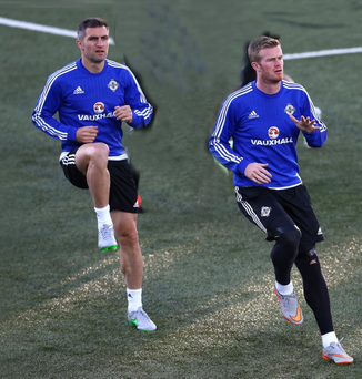 Through the paces: Aaron Hughes and Chris Brunt train in Torshavn
