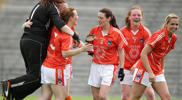 Victory leap: Armagh players celebrate their quarter-final win which earned them a semi-final against Dublin