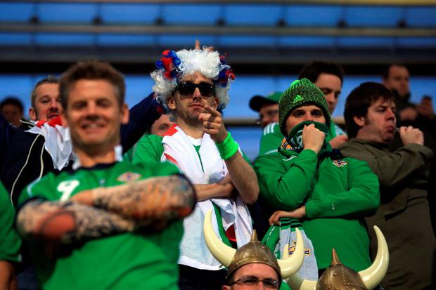 Northern Ireland fans in the stands during the UEFA European Championship Qualifying match at the Torsvollur, Torshavn.