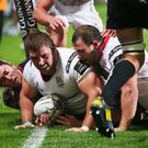 Guinness Pro12: Ulster v Ospreys, Kingspan Stadium, Belfast. Willie Faloon helps Wiehahn Herbst over for an Ulster try