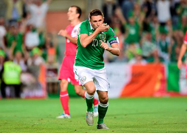 Republic of Ireland's Robbie Keane celebrates scoring his sides third goal of the match during the UEFA European Championship Qualifying match at the Estadio Algarve, Faro. Picture date: Friday September 4, 2015.