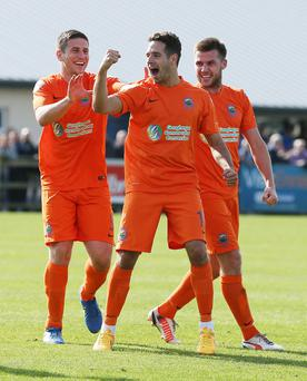 Case for defence: Sean Ward is congratulated after scoring Linfield's winner