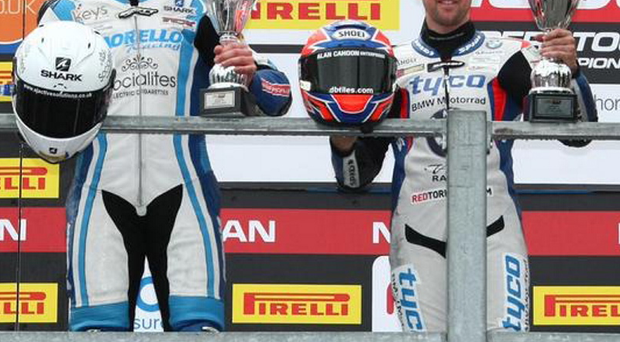 Fight to finish: winner Alastair Seeley (right) and second-placed rival Josh Elliott on podium at Oulton Park yesterday after epic battle in British Superstock championship