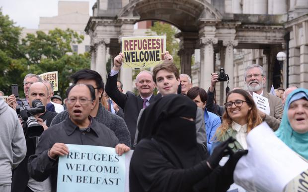 Belfast hosts vigil for refugees: Martin McGuinness and Gerry Adams pictured at the event at Belfast City Hall. Photo: Arthur Allison