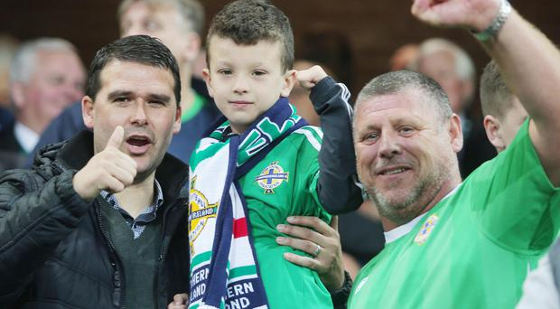 Euro 2016 Qualifier - Northern Ireland Vs Hungary at Windsor Park, Belfast. Northern Ireland legend David Healy watching the match with fans. Picture by Jonathan Porter/PressEye