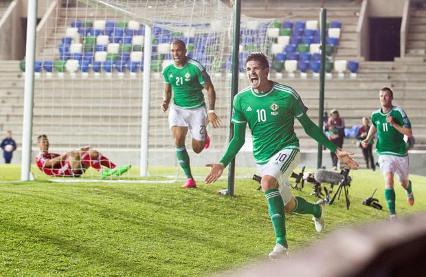 Northern Ireland's Kyle Lafferty celebrates scoring his side's first goal of the game during the UEFA European Championship Qualifying match at Windsor Park, Belfast. Photo: Liam McBurney/PA