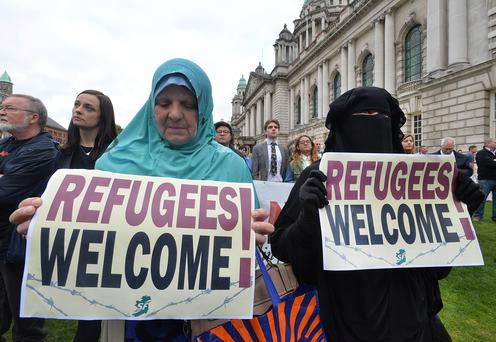 Hundreds of people gather at Belfast City Hall yesterday to show their solidarity with refugees fleeing Syria