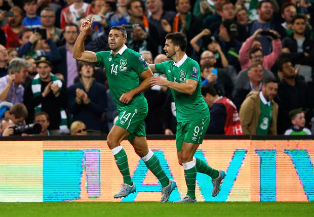 Jonathan Walters of the Republic of Ireland (14) celebrates with Shane Long (9) as he scores their first goal during the UEFA EURO 2016 Group D qualifying match between Republic of Ireland and Georgia at Aviva Stadium on September 7, 2015 in Dublin, Ireland. (Photo by Ian Walton/Getty Images)