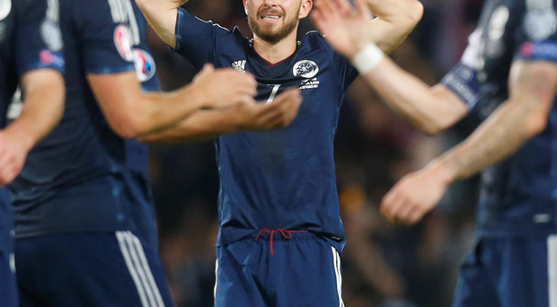 So close: Scotland's James Morrison (centre) reflects on what might have been at Hampden Park