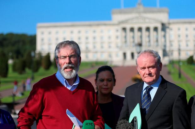 Sinn Fein president Gerry Adams (second left) and Deputy First Minister Martin McGuinness (centre) outside Stormont in Belfast as they arrive for negotiations on the future of the power-sharing administration in Northern Ireland. Photo: Niall Carson/PA