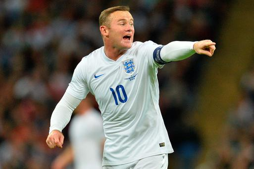 England's striker Wayne Rooney gestures during the Euro 2016 qualifying group E football match between England and Switzerland at Wembley Stadium in west London on September 8, 2015. AFP PHOTO / GLYN KIRK