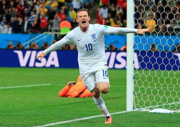 Spot on: Wayne Rooney scores his 50th England goal one more than Bobby Charlton, to set a new record