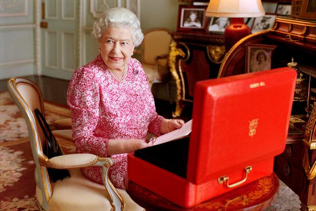 An official picture showing the Queen at work at her desk has been released to mark the moment she becomes the longest reigning monarch in British history
