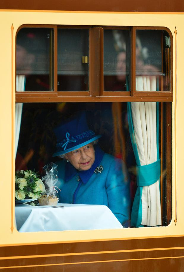 Queen Elizabeth II looks on at Waverley Station from the window of the steam locomotive 'Union of South Africa' on September 9, 2015 in Edinburgh, Scotland.