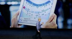 Apple CEO Tim Cook discusses the new iPad during the Apple event at the Bill Graham Civic Auditorium in San Francisco, Wednesday, Sept. 9, 2015. (AP Photo/Eric Risberg)