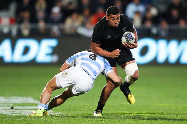 Charles Piutau of the New Zealand All Blacks is tackled by Tomas Cubelli of Argentina during The Rugby Championship match between the New Zealand All Blacks and Argentina at AMI Stadium on July 17, 2015 in Christchurch, New Zealand. (Photo by Hagen Hopkins/Getty Images)