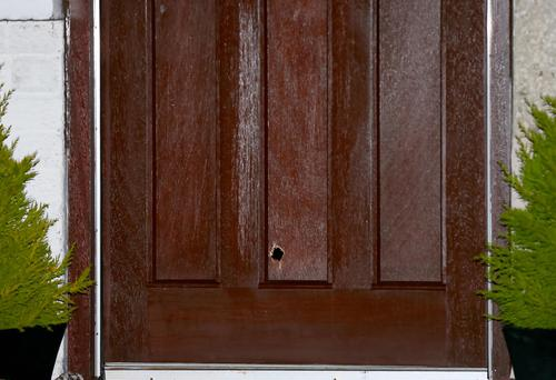 The bullet hole on the front door of the property. Pic: Kevin Scott
