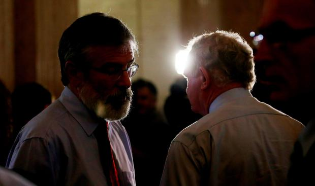 Sinn Fein's Gerry Adams and Martin McGuinness in the Great Hall of Stormont as powersharing in Northern Ireland hangs by a thread after the Democratic Unionists vowed to collapse the institutions if they are not suspended to deal with the fallout from an IRA murder.