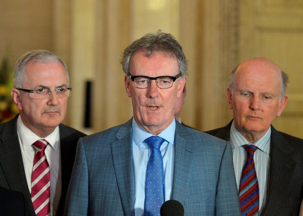 Ulster Unionist party leader Mike Nesbitt (2nd L) answers questions during a press conference at Stormont (Photo by Charles McQuillan/Getty Images)
