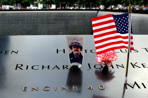 A photo of New York firefighter Richard John Kelly, J., is placed in his name at the 9/11 memorial during 14th Anniversary ceremony of the terrorist attacks, on September 11, 2015 in New York