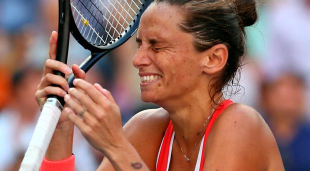 Magic moment: Roberta Vinci celebrates her shock victory over Serena Williams