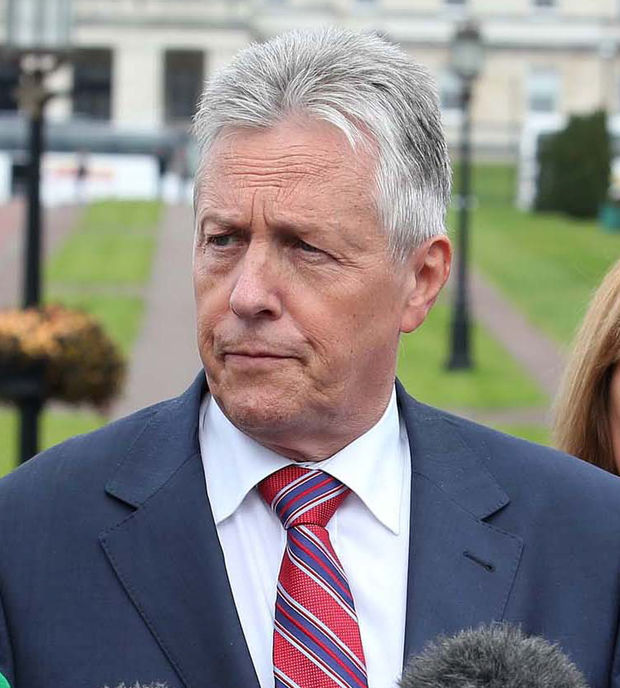 Peter Robinson announced that all but one of the DUP's ministers would withdraw from the executive