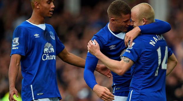 Everton's Brendan Galloway and Ross Barkley congratulate Everton's striker Steven Naismith after scoring his second goal against Chelsea. Pic Paul Ellis