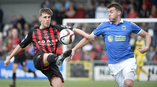 Crusaders star Gavin Whyte in action with Linfield's Stephen Lowry