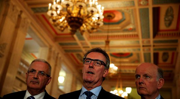 Ulster Unionist Party leader Mike Nesbitt (centre) alongside Danny Kennedy (left) and Michael McGimmpsey (right) speaking to the media at Stormont, Belfast. Brian Lawless/PA Wire.
