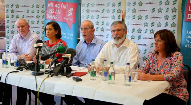 Sinn Fein northern chairman Bobby Storey (centre) has accused unionists of using his