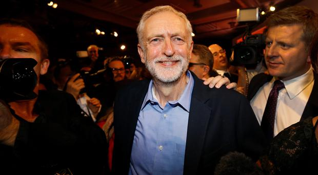 Jeremy Corbyn smiles as he leaves the stage after he is announced as the new leader of the Labour Party. (AP Photo/Kirsty Wigglesworth)