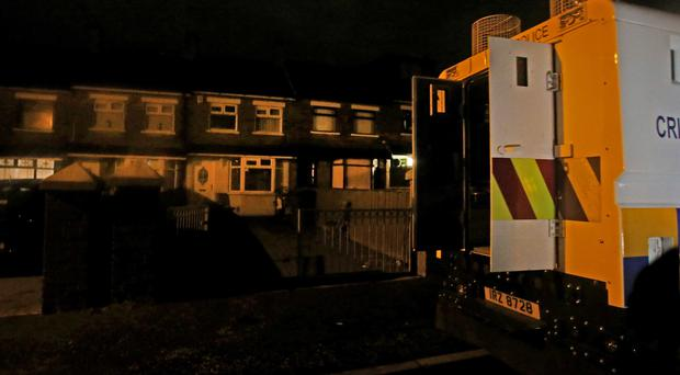 The scene of a fatal house fire at Ladbrook Drive in Ardoyne, north Belfast last night