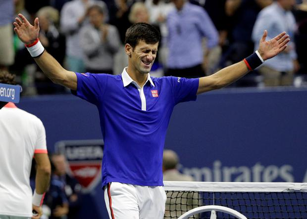 Novak Djokovic celebrates after beating Roger Federer in the men's championship match of the US Open.