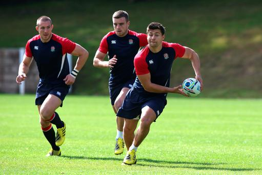Moving forward: England's Ben Youngs goes on the run in training with Mike Brown (left) and George Ford in support