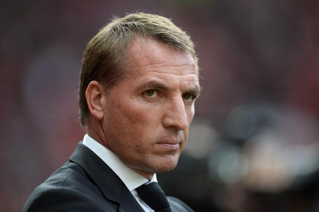 Liverpool's Northern Irish manager Brendan Rodgers arrives for the English Premier League football match between Manchester United and Liverpool at Old Trafford in Manchester, north west England, on September 12, 2015. AFP/Getty Images