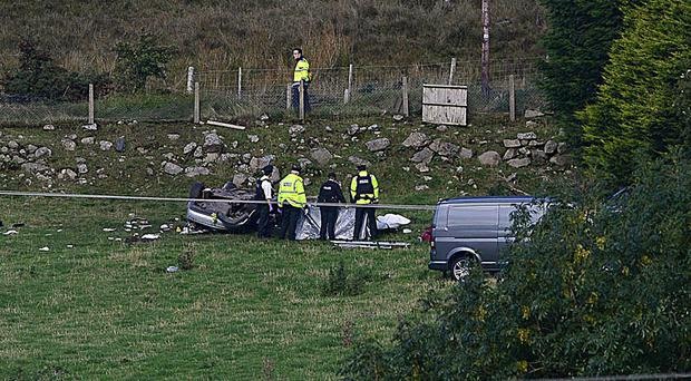 The car finished up in a field following the horrific crash. :Pic: Arthur Allison/Pacemaker Press