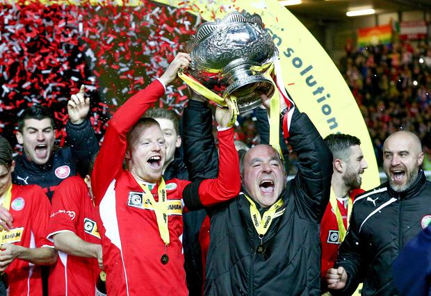 Pictured is Cliftonville's George Mc Mullan and Tommy Breslin as they win the Wasp Solutions Cup Final at Windsor Park in Belfast. Saturday 24th January 2015. Photo: Kevin Scott