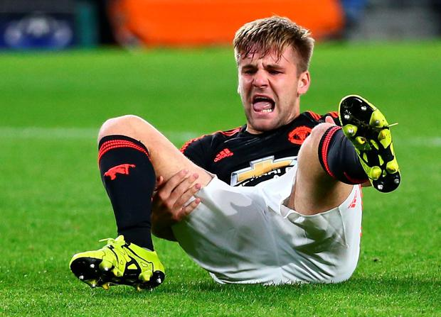 Manchester Uniteds Luke Shaw grimaces after being injured during the Champions League Group B soccer match between PSV and Manchester United at Philips stadium in Eindhoven, Netherlands, Tuesday, Sept. 15, 2015. (AP Photo/Peter Dejong)