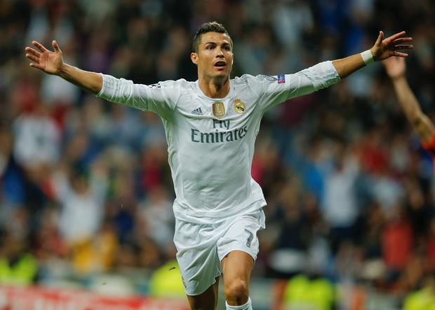 Real Madrid's Cristiano Ronaldo celebrates after scoring after an hat trick during a Group A Champions League soccer match between Real Madrid and Shakhtar Donetsk at the Santiago Bernabeu stadium in Madrid, Spain, Tuesday, Sept. 15, 2015. (AP Photo/Paul White)