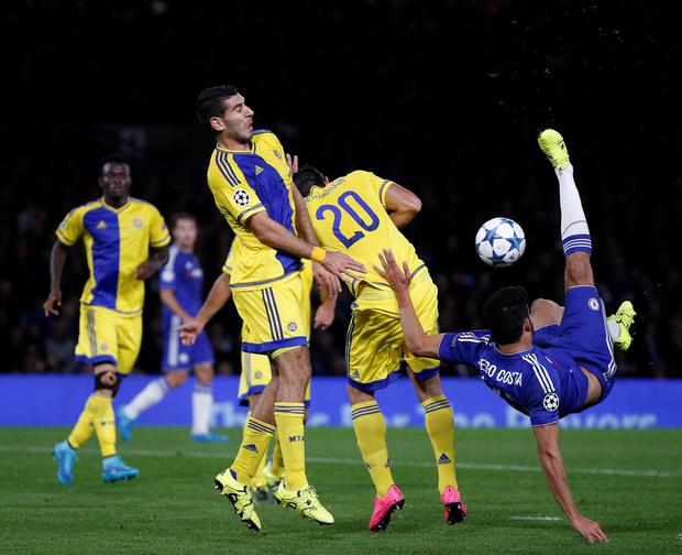 Chelsea's Brazilian-born Spanish striker Diego Costa (R) unsuccessfully attempts an over-the-head shot on goal during the UEFA Champions League, group G, football match between Chelsea and Maccabi Tel Aviv at Stamford Bridge in London on September 16, 2015. AFP/Getty Images