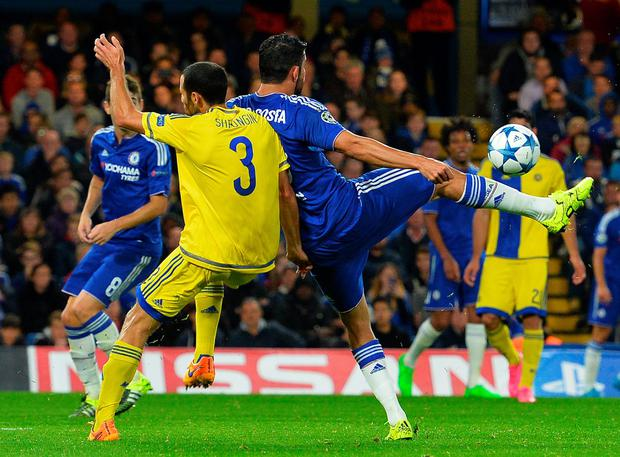 Brazilian-born Spanish striker Diego Costa shoots to score the team's third goal during the UEFA Champions League, group G, football match between Chelsea and Maccabi Tel Aviv at Stamford Bridge in London on September 16, 2015. AFP/Getty Images
