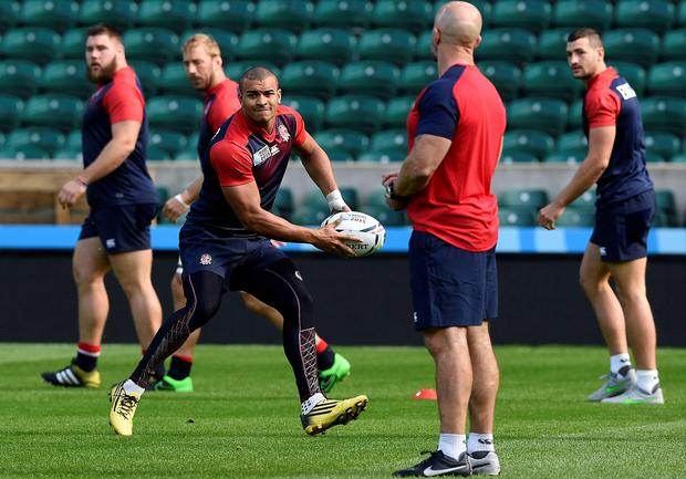 England's centre Jonathan Joseph (C) takes part in a training session at Twickenham Stadium, south west London, on September 17, 2015 on the eve of their opening match of the 2015 Rugby Union World Cup against Fiji. AFP PHOTO / FRANCK FIFE RESTRICTED TO EDITORIAL USEFRANCK FIFE/AFP/Getty Images