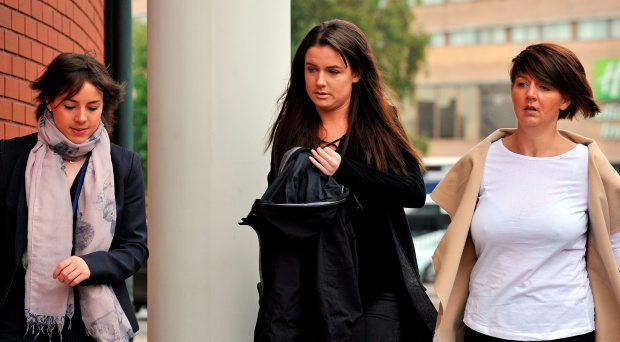 Gaby Scanlon (centre) who had to have her stomach removed after drinking a cocktail mixed with liquid nitrogen bought on her 18th birthday from Oscar's bar in Lancaster, arrives at Preston Crown Court in Lancashire. Photo: Peter Byrne/PA