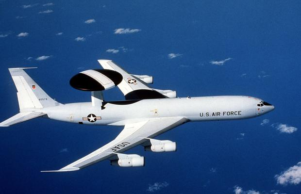 FILE PHOTO: An air-to-air view of an E-3A Sentry aircraft equipped with an Airborne Warning and Control System (AWACS) (Photo by USAF)