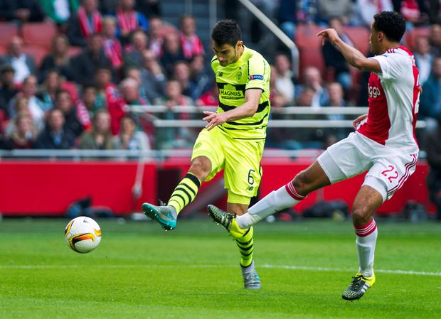 Celtic's Nir Bitton scores past Ajax defender Jairo Riedewald, right, during the Europe League Group A soccer match between Ajax Amsterdam and Celtic Glasgow at the ArenA stadium in Amsterdam, Netherlands, Thursday, Sept. 17, 2015. (AP Photo/Patrick Post)